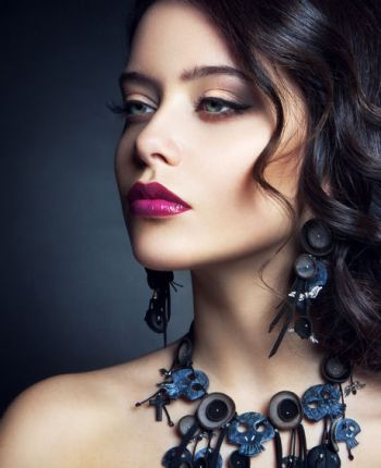 Close-up studio portrait of beautiful woman.